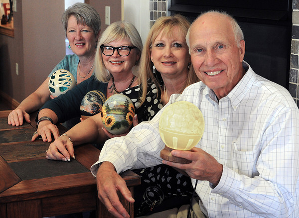 Artists pose at the Mirasol Communtiy Center with the eggs they painted for an auction that will benefit Stepping Stones Adult Day Program. From back to front are Billie J. Colson, Suzi Holland, Donita Fogle and Richard Schilling.