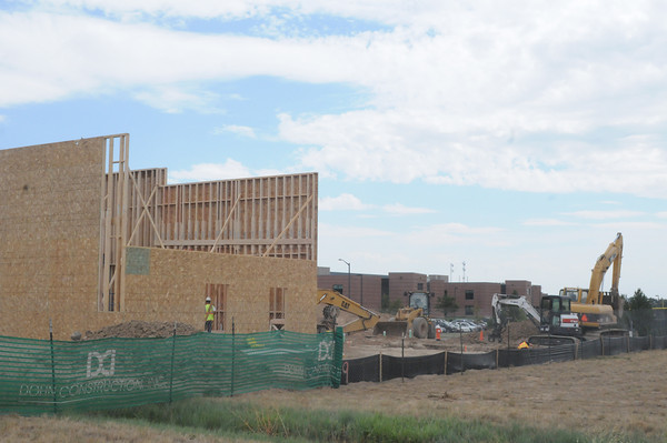 Construction crews work Thursday, Aug. 30, 2012, at the site of a future Freddy's Frozen Custard & Steakburgers restaurant in east Loveland just north of Mountain View High School, seen in the background. (Photo by Craig Young)