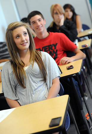 With their cell phones sitting at the corners of their desks, Mountain View High School students listen as teacher Nick Vasa explains his classroom rules for cell phones Monday, their first day back at school. From front to back are Kendie Gunn, 15, Jake Ashe, 16, Jada Leigh, 16, and Danielle Carrera, 15.