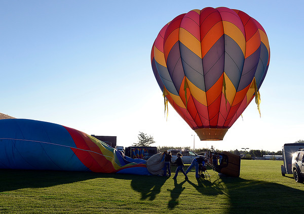 Crews rig hot air balloons for launch Friday in Loveland.