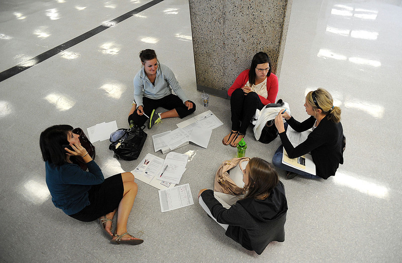 From left, Melissa Ring, Tara Nichols, Kelly Williams, Katie Johnson and Valerie Wirt fill out healthcare benefit forms during a break in the Thompson School District new teacher orientation at Thompson Valley High School on Friday morning.