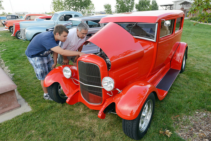 Zack Neave, 17, left, and his grandfather Tony Leon look at a 1928 Ford 2-door dedan on display with other classic cars during the Road Knights Car Show on Friday, Aug. 10, 2012 at The Ranch. The car show continues through Sunday with a blow up car event scheduled for 4 p.m. today.