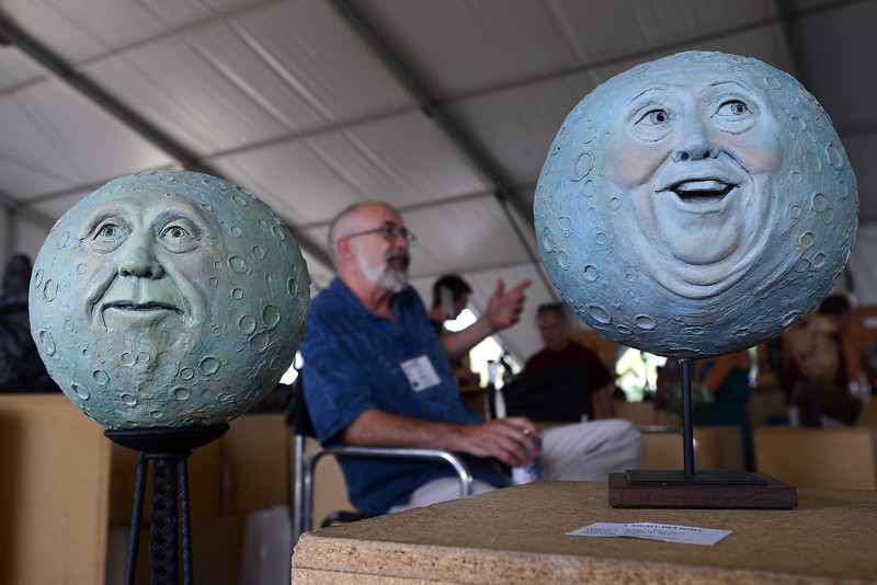 Several of Marlys Boddy's ceramic sculptures are on display at Sculpture in the Park while her husband Joe Boddy, back, chats with an attendee on Saturday, Aug. 11, 2012 at the Benson Sculpture Garden.