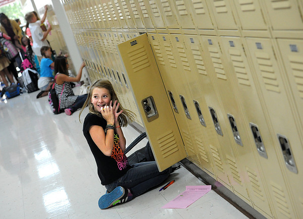 Victoria Daniels, 12, is so excited that she got her locker open on her first try Friday  on her first day of sixth-grade at Lucile Erwin Middle School in Loveland.