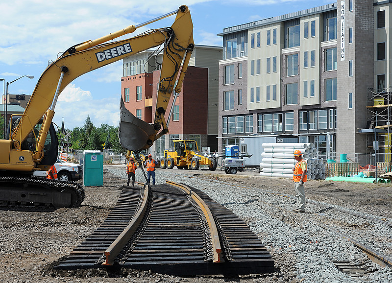 A section of the railroad track is moved Monday near Mason Street and Cherry Street in Fort Collins as part of the The Burlington Northern Santa Fe Railway track replacement project. Mason Street is closed to vehicles and foot traffic while work continues on the railroad replacement and maintenance.