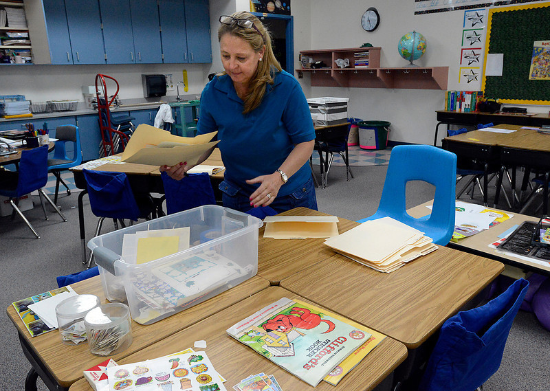 Nita Starr, third-grade teacher at Ivy Stockwell Elementary School, orgainzes and sets up her classroom Thursday at the school. Instead of having individual desks, most of the classrooms are set up with clusters of desks or tables as part of the new STEM focus at the school.
