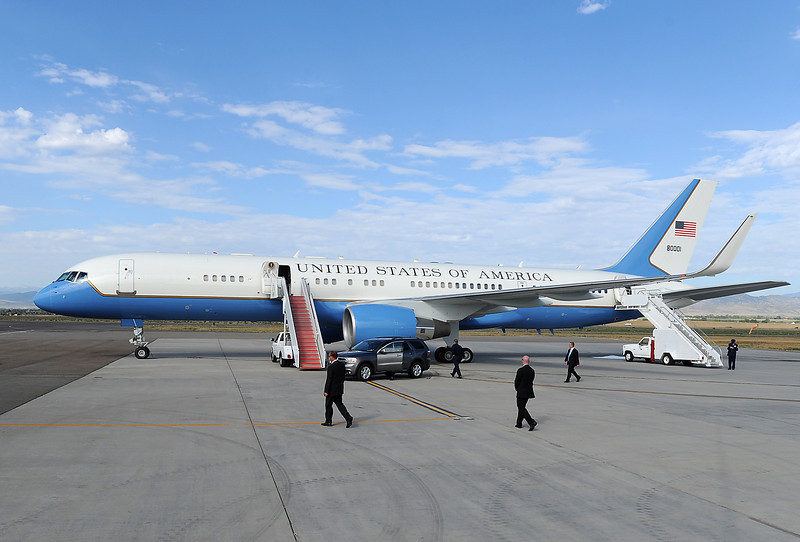Secret Service walk across the tarmac as they wait for President Obama to arrive at the Fort Collins-Loveland Municipal Airport Wednesday morning in Loveland.
