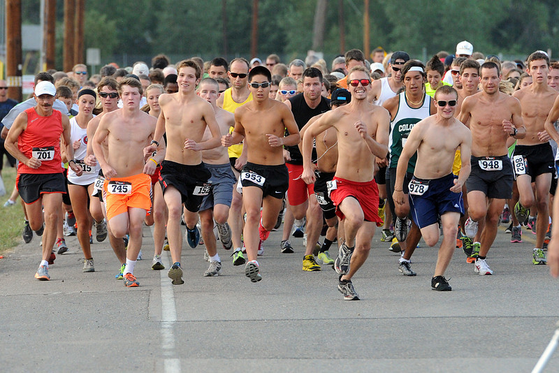 Runners take off at the start of the Valley 5000 road race on Friday, Aug. 17, 2012 at Fairgrounds Park. This year's event featured 384 runners with Kendra Larson finishing first in the women's division and Daniel Lara winning the men's division.