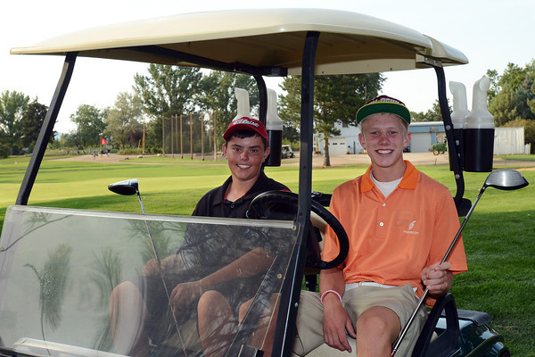 Loveland High School sophomore Evan Buchalski, left, and golf teammate Cole Bundy pose together Tuesday, Aug. 7, 2012  after practice at The Olde Course at Loveland.