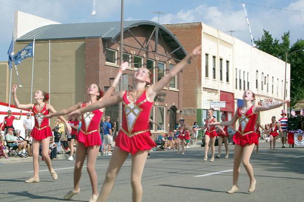 Dancers from the Golden Girls Baton Academy toss batons in the air Saturday at the Corn Roast Parade in downtown Loveland.
