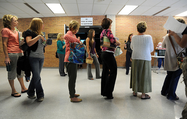 Teachers new to the Thompson School District wait in line during new teacher orientation at Thompson Valley High School on Friday.