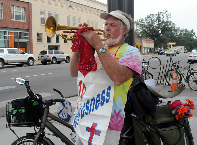 Traveling evangelist Richard Jacobson plays his trumpet Wednesday afternoon at the corner of Fourth Street and Cleveland Avenue in downtown Loveland. (Photo by Craig Young)