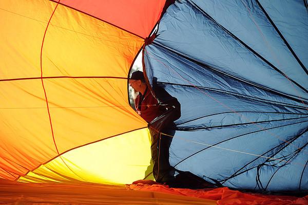 Pilot Jim Pansa prepares his balloon, 's Wonderful, for flight on Friday morning.