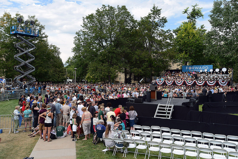 Attendees begin to fill stands set up on the Colorado State campus in Fort Collins, Colo. in anticipation of President Barack Obama's visit Tuesday, Aug. 28, 2012.