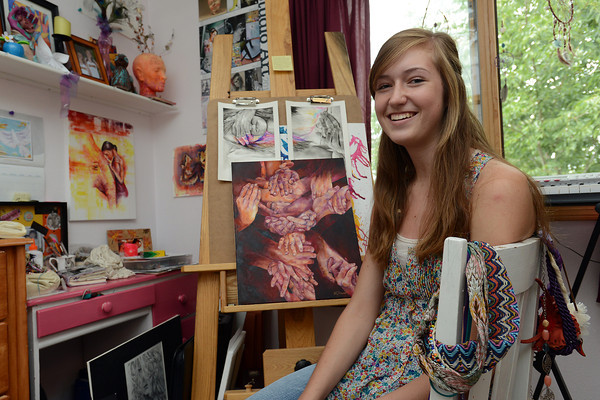 Loveland HIgh School senior Hannah Circenis poses Aug. 22, 2012 in her studio space at her home. Hannah will be participating again this year in Pastels on Fifth drawing a greyhound dog.