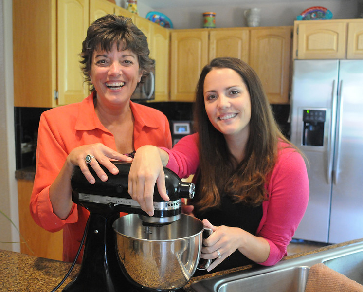 Liz Dudek and her mom, Lisa Rabson, have launched Quiet Time Cooks, a recipe service for busy cooks. They're shown here in Rabson's kitchen in her Loveland home. (Photo by Craig Young)