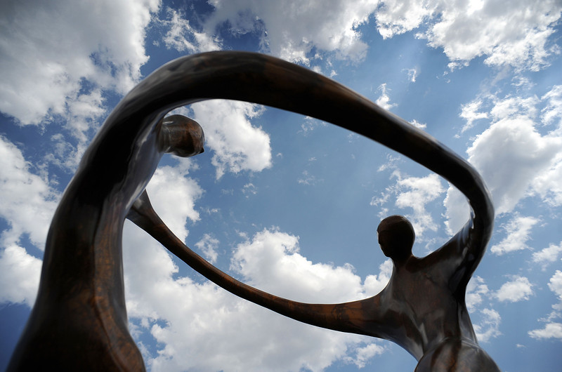 "A sculpture titled ""Dance of Love, Dance of Life"" by Bob Wilfong stands out against a a partly cloudy sky on Saturday during the Loveland Sculpture Invitational at Loveland High School."