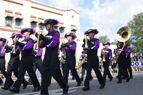 Members of the Mountain View High School band march through downtown Loveland on Saturday. Behind the band, members of the school's football team also raised awareness of their program.