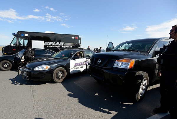 Loveland Police and SWAT team members pack up gear after working with Secret Service to keep the airport secure as President Obama and Air Force One flew out of Loveland Wednesday.