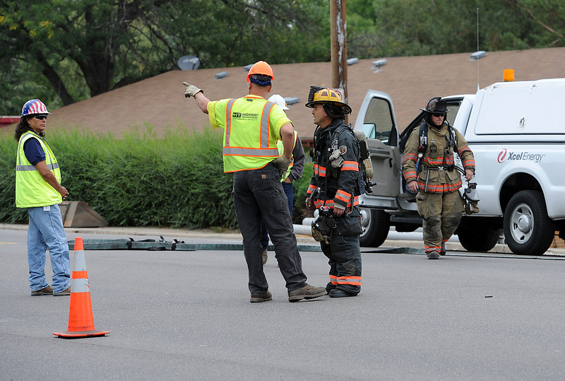 Loveland Fire and Rescue firefighters and Excel Energy crews work at the scene of a natural gas line break Thursday north of 29th Street on Taft Avenue in Loveland.