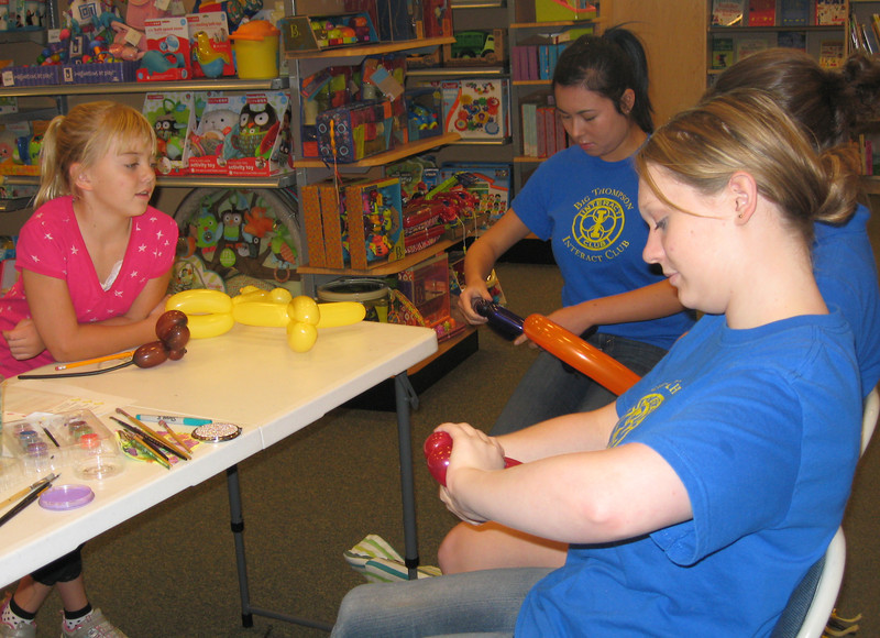 20rhadic.jpg Nine-year-old Kenzy Dreher, left, looks on while members of the Big Thompson Interact Club make balloon animals Sunday during the Loveland Rotary Dictionary Book Fair.