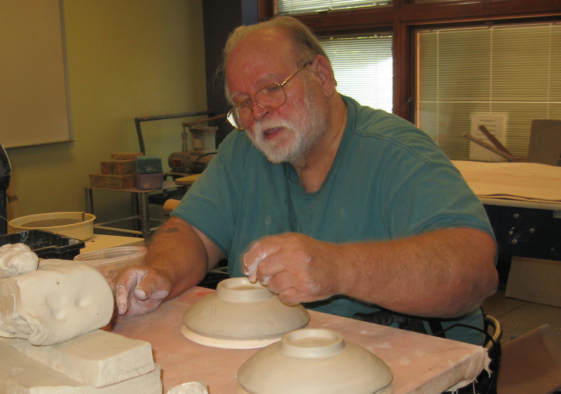 20rhbow~1.jpg Loveland potter Michael Janes stamps a soup bowl Sunday during a bowl-a-thon held in advance of November's Empty Bowls dinner fundraiser.