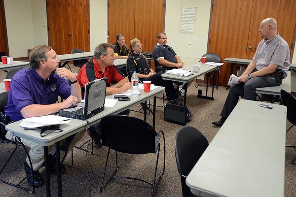 Loveland Police Sgt. David Murphy, right, conducts an in-service training session for the department's school resource officers on Tuesday afternoon. Left to right in the middle are officers Bryan Bartnes, Bruce Boroski, Bobbie Jo Pastecki and Benito Avitia and at rear is Jennifer Hines.