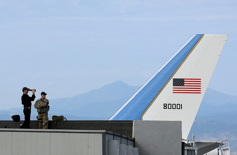 With Air Force One in the background, Secret Service and Loveland SWAT officers stay on the lookout from the roof of the terminal as they wait for President Obama to arrive at the Fort Collins-Loveland Municipal Airport Wednesday morning in Loveland.