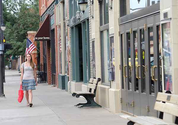 Catherine Hackney walks on the 200 block of east Fourth Street in downtown Loveland Monday during her lunchbreak from work.