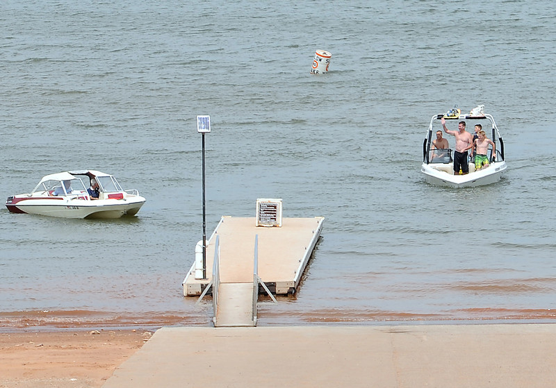 The Haan family of Berthoud, right, wave to other boaters Wednesday afternoon while pulling into the boat ramp after wave surfing. Paul Haan said he was suprised that the boat ramps are still open. He and his family boat at Carter Lake often and he said he remebers other years when the ramps were already closed by this time of year. Water elevation at Horsetooth Reservoir are dropping leaving most of the boat rams there on dry land. After drought conditions this summer, Carter Lake's three boat ramps still remain open, leaving boaters a place to get on the water close to Loveland.