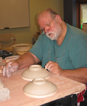20rhabow~2.jpg Loveland potter Michael Janes stamps a soup bowl Sunday during a bowl-a-thon held in advance of November's Empty Bowls dinner fundraiser.
