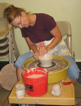 20rhabow.jpg Loveland potter Nancy Zoller throws a bowl that will become one of the soup bowls available for the Empty Bowls dinner in October to support the Food Bank for Larimer County.