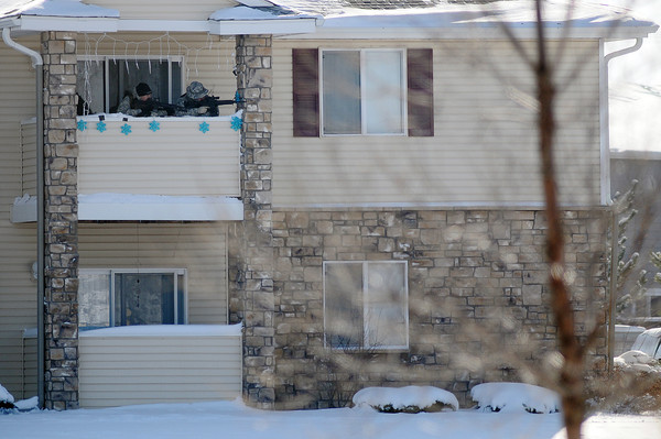 Members of Loveland SWAT team train their guns on an apartment at Thompson Valley Apartments where a suspect in the armed robbery of the Mini Stop at 1039 S. Lincoln Ave. was inside.