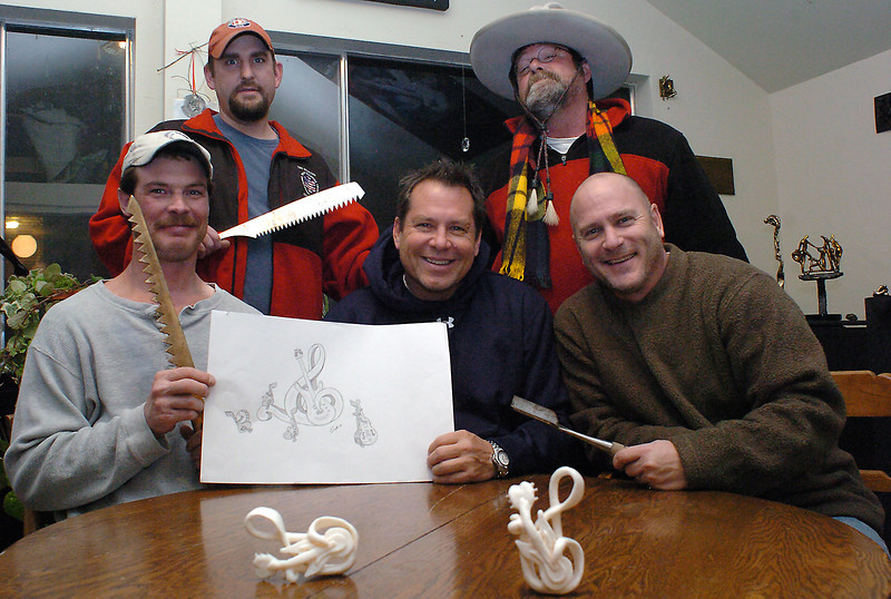 Loveland residents who are members of a snow sculpting team pose recently with some tools of the trade and models of the sculpture they plan to build during a competition in January in Breckenridge. From left are Steve Mercia, Garett Dreiling, Randy Amys, Jack Kreutzer and Randy Shorman.