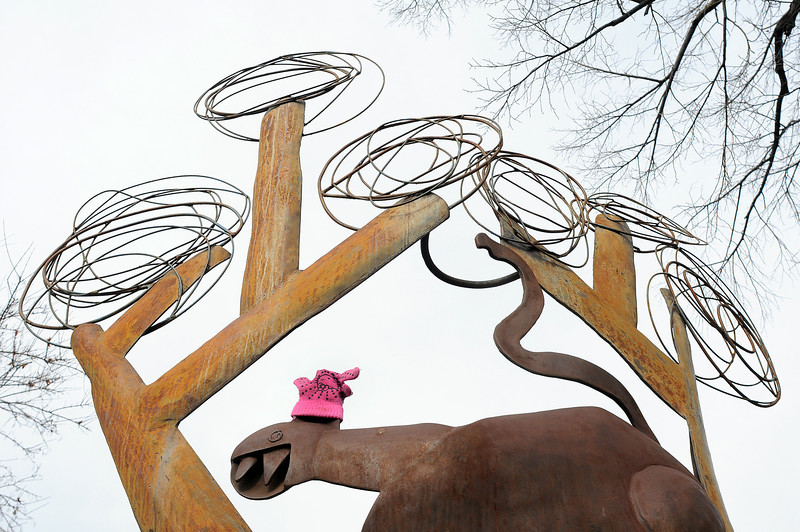 "A lone lost glove rests atop the head of the cat on a sculpture called ""Oreo"" by artist Rafe Ropek on Tuesday afternoon as clouds threaten snow. A storm is expected to drop one to three inches of snow throughout the day with temperatures in the mid 20s."