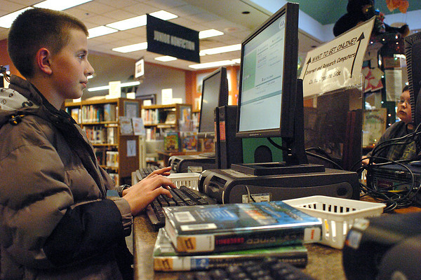 Anson Lichtfuss, 12, left, and Robby Hill, 11, use computers in the children's section of the Loveland Public Library on Wednesday. The library has a variety of activities scheduled for children over their winter break from school including a movie afternoon Dec. 23 from 1 p.m. to 3 p.m., a Rock Band tournament from 1 p.m. to 3 p.m. on Dec. 31, and a game afternoon from 2:30 p.m. to 4:30 p.m. on Jan. 5.