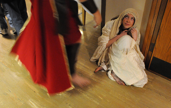 Larry Hagan, playing the part of a Roman soldier, hassles Samantha Wacker, 14, as she plays the part of a beggar during A Night in Bethlehem event at the First United Methodist Church on Sunday night. The church held the event to depict the setting of the Christmas story.