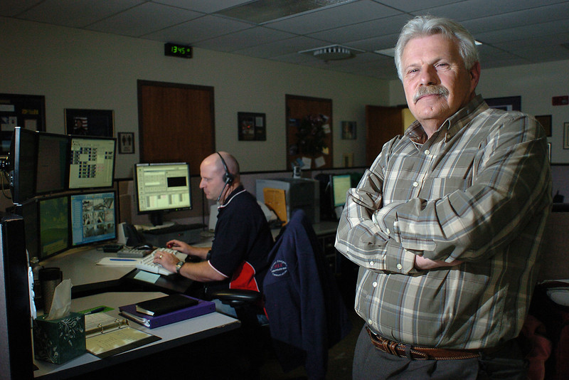 Tom Raabe poses Tuesday in the Communications Center at the Loveland Police Department where he recently retired as the director of communications for the city.