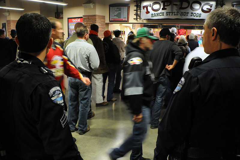 Brent Newbanks, left, and Jim Betrus of the Loveland Police Department work the Colorado Eagles hockey game at the Budweiser Events Center on Sunday night. Loveland has grown in the last decade and the Loveland Police Department has had to include The Ranch where the Eagles play and Centerra in their patrols.