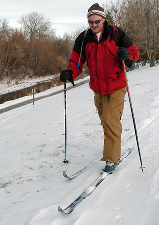 Loveland resident Guy Keith skis across the snow-covered ground at Centennial Park on Saturday afternoon. Keith said he wanted to get outside for a little exercise and had considered going snowshoeing, but there wasn't quite enough snow.