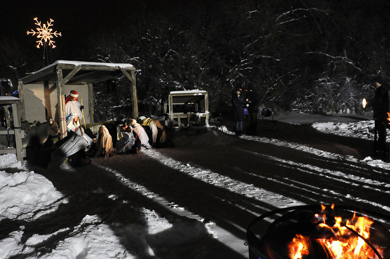 Shadows from a crowd fall on a Live Nativity during in a snow storm on Wednesday night at Summitview Community Church.