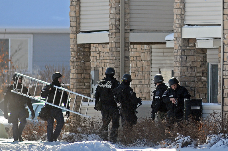 Members of the Loveland SWAT team prepare to enter an apartment on Wednesday at Thompson Valley Apartments at 1451 10th Street Southwest. A man who police suspect robbed the Mini Stop at 1039 S. Lincoln Ave. was arrested without incident.
