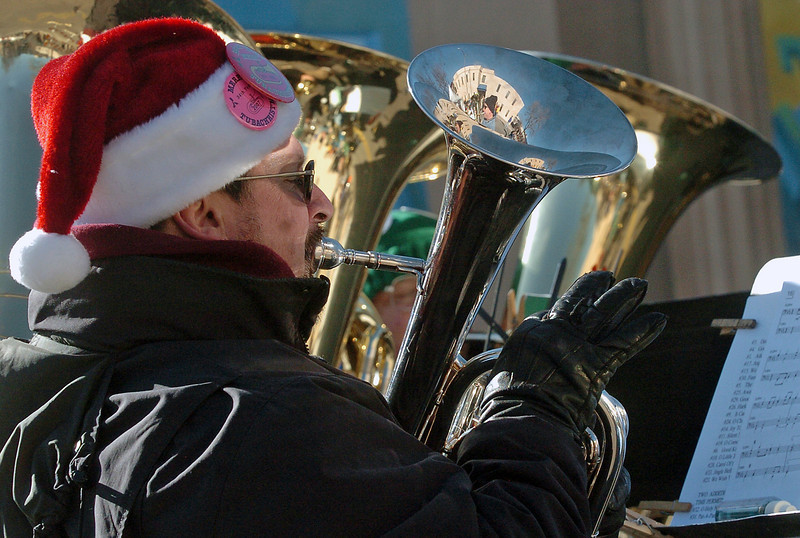 Lenny Kellogg plays a tuba in downtown Loveland on Dec. 5, 2009 during a ceremony dedicating the mural painted by Sheldon James on the side of the Loveland Community Health Center building.