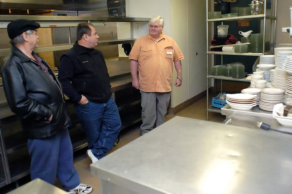Chuck Liss, left, and Jim Parilla speak with Prudential Real Estate of the Rockies Realtor Bob Ford in the kitchen of The Wayside Inn in Berthoud on Friday.