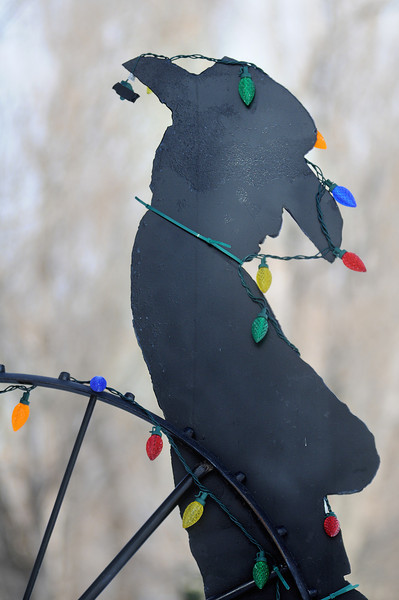 A silhouette cutout of a cowboy seems to be in the holiday spirit along County Road 13 just south of Loveland on Wednesday afternoon.