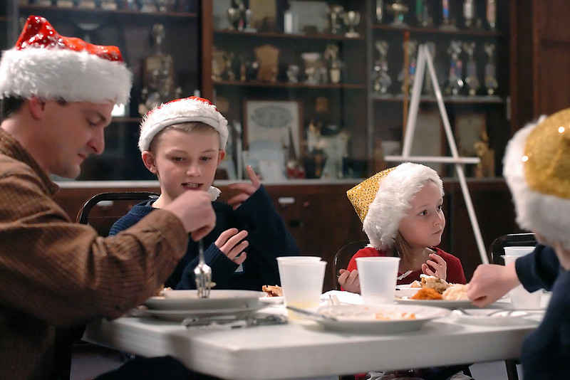 Members of the Doman family from Berthoud enjoy a meal during a free Christmas dinner Friday at the Associated Veterans Club in downtown Loveland. From left are Berrett, Taylor, 13, Josie, 7, and Jacob, 9. This was the second year the Christmas day dinner was held at the Veterans Club.
