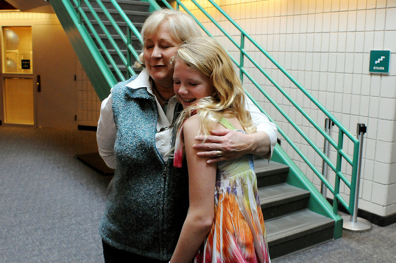 Kristen Ellis of Loveland hugs Miranda Marston, 14, of Coronado, Calif., during a meeting at the Chilson Recreation Center where the lives of the two first intersected on Dec. 27, 2000, when Ellis helped rescue Marston when she was drowning in the pool. Now, a decade past, Ellis works as a writer/photographer at the Poudre School District and Marston is now going out for the diving team at Coronodo High School.