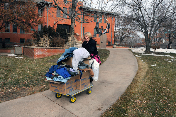 Diana Montgomery, administrative technician for the City of Loveland public works department, hauls coats collected at the Chilson Recreation Center and the Loveland Public Library to a central collection area at Tuesday at the Civic Center. The coats will be taken to the House of Neighborly Service where they will be redistributed to area shelters.