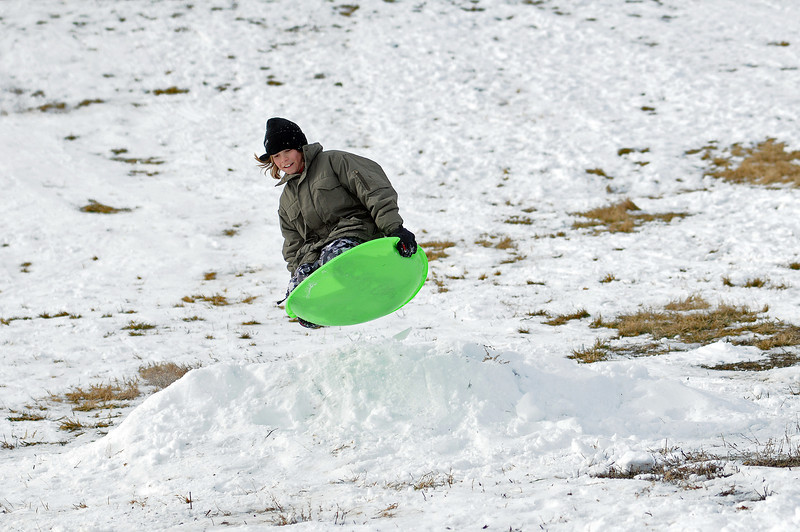 Justin Smithey, 10, of Eaton launches off a jump at the Kroh park sledding hill on Dec. 13.