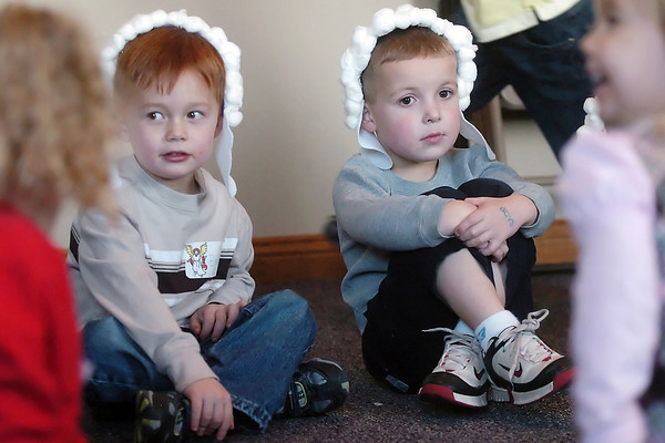 Braden Turner, 4, back left, and Levi Scheck, 4, wear their costumes as they play games with other youngsters while waiting to perform as sheep in a Christmas play Saturday at Abiding Love Lutheran Church, 2825 E. First St. during the Christmas for Kids event.